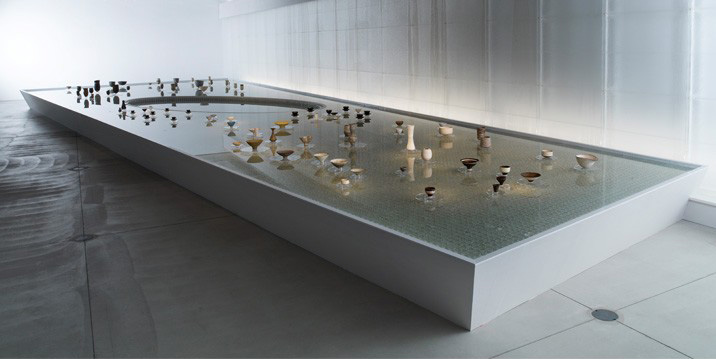 The Japanese architect Tadao Ando designed a rectangular pool for the exhibition on which Rie's ceramics appear to float.